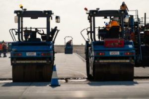 Equipment being used to add the final layer of runway pavement