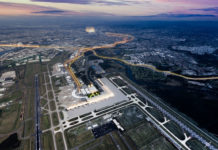 Architectural concept image of a new northern integrated domestic and international terminal